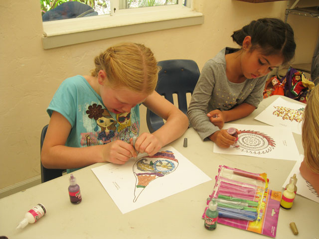 05-Shyamamohini and Shivani work on an arts and crafts project
