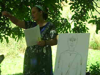 08-Damayanti Didi leads a class about wearing tilak