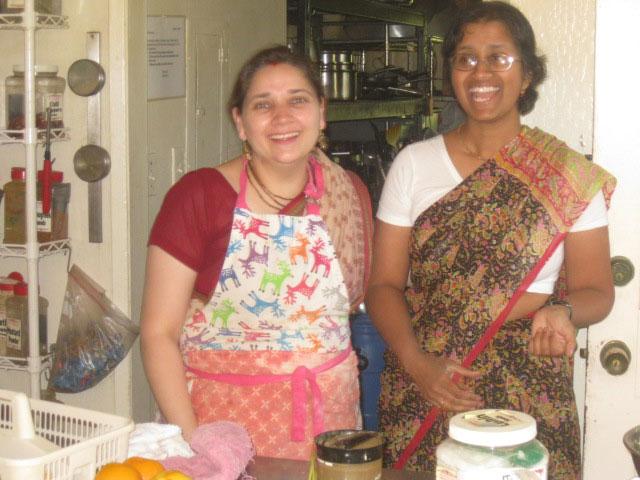 27-Abha Didi and Amiyakanti Didi prepare the noon offering