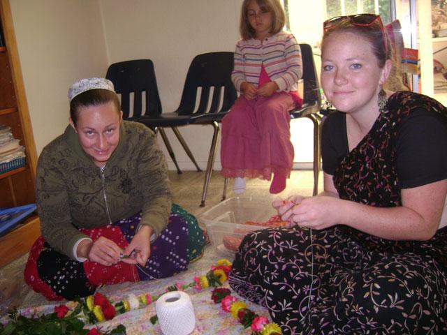 33-Damayanti Didi and Devaki Didi make garlands to offer to the deities