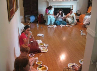 12-All the devotees and their guests contentedly honoring prasad